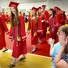 "BRYAN EATON/Staff photo. Amesbury High School graduates parade past applauding kindergartners in the Cashman School gymnasium as they do a ""walk through"" ahead of their graduation Friday night. Many of the seniors attended the school with some of their teachers still there after the past eight years since they left."