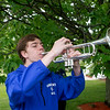 JIM VAIKNORAS/Staff photo Michael Miller of Seabrook, plays taps at the Memorial Day Service at town hall Sunday morning. Miller is a student at Winnacunnet and plays in their band.