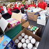 BRYAN EATON/Staff photo. Agents from Keller WIlliams Realty in Newburyport unload toiletries and foodstuffs at the Pettengill House Food Pantry in Salisbury on Thursday morning for their annual Red Day (Renew, Energize and Donate) where they give back to the communities they serve. Also on the receiving end of their efforts were New Hampshire Society for Prevention of Cruelty to Animals (NHSPCA), The Community Giving Tree, Our Neighbors Table, Jeanne Geiger Crisis Center and Emmaus House.