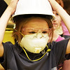 BRYAN EATON/Staff photo. The Bresnahan School held a STEM (Science, Technology, Engineering and Math) Fair when different companies and organization gave the students hands on experience. Lucan Palen, 9, donned protective gear in a display by the EPA Emergency Response team that had a model simulation of a contaminated water spill in the Merrimack River.