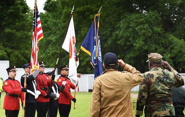 BRYAN EATON/Staff photo. The Amesbury Police and Fire Department's Color Guard hoist the colors during the Pledge of Allegiance.
