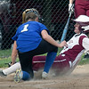 BRYAN EATON/Staff photo. Newburyport's Madison Duford is out at home by Georgetown pitcher #1 on and overthrown ball.