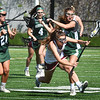 BRYAN EATON/Staff photo. Margaret Cote heads for the turf as the Hornets put the pressure on.