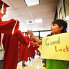 "BRYAN EATON/Staff photo. Aidan MacIntire, 9, gives high-fives to Amesbury High Seniors as they leave the Cashman School after a ""walk through"" on Tuesday morning, as he and schoolmates held signs of encouragement. They paraded through the halls of the school to celebrate their accomplishments and to model how perserverance can help you achieve life goals."