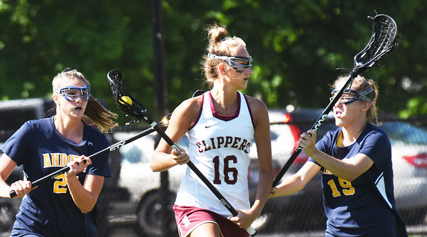 BRYAN EATON/Staff photo. Newburyport's Hannah Schilling looks for an open teammate as Andover's #21 and #19 move in.