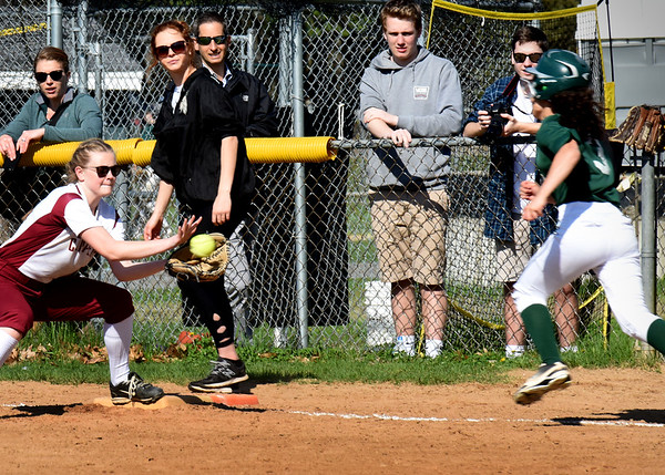 BRYAN EATON/Staff photo. Clipper first baseman Courtney Walsh gets the throw forcing out Fiona Hill.