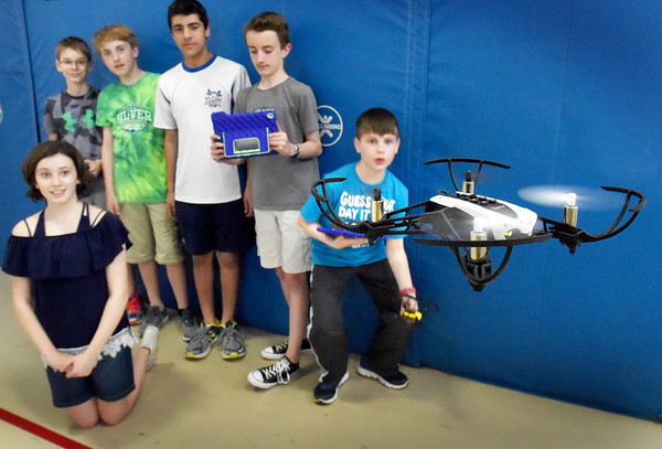 BRYAN EATON/Staff photo. Amesbury Middle School students check out a drone the class has been working on in the gymnasium after school on Wednesday. Computer education teacher Jim Queenan's class have programmed the drones while his counterpart,  Jim Firmes' class has been building them with a grant from the Amesbury Education Foundation, Inc.