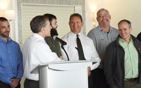 BRYAN EATON/Staff photo. Rick Picone, center, operations manager for SPS is all smiles as he listens to company president Wayne Capolupo as  praising co-workers and Salisbury firefighters who all came to his rescue when he suffered a major heart attack in January saving his life. The firefighters were guests for their business luncheon as a gesture of thanks.