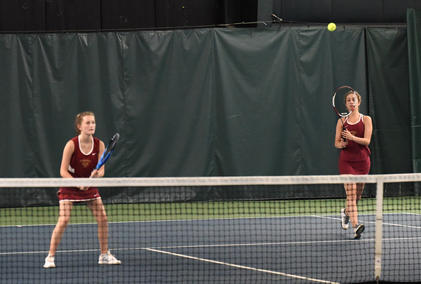 BRYAN EATON/Staff photo. Molly Page, left, and Meredith Vartabedian in second doubles.