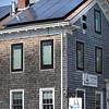 BRYAN EATON/Staff photo. Portside Family Dental in Newburyport installed solar panels a couple years ago.