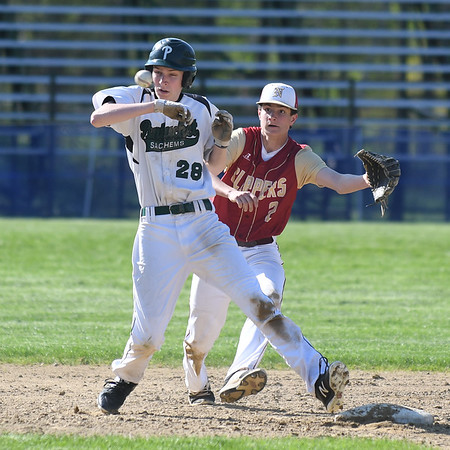 JIM VAIKNORAS/Staff photo Pentucket's Nick Cochran gets safely back to second as Newburyport's Ryan Archie waits for the pick off throw at Pentucket Tuesday afternoon.