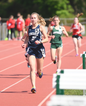 JIM VAIKNORAS/Staff photo Hamilton-Wenham's Anna Cassidento runs the 2 mile in the Cape Ann League Track and Field championships at Mascomonet in Boxford Saturday.