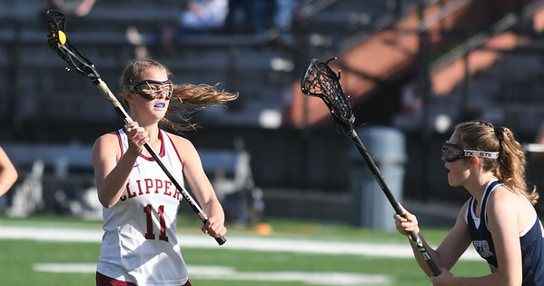 JIM VAIKNORAS/Staff photo Newburyport's Ashley McIntire looks to pass during the Clippers game against Exeter at World War Memorial Stadium in Newburyport Friday.