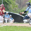JIM VAIKNORAS/Staff photo  Newburyport's Michael Twomey successfully avoids the tag of Triton catcher Tyler Godfrey during their game at Triton Thursday.