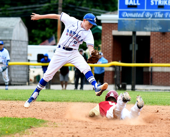 JIM VAIKNORAS/Staff photo Newburyport's Tyler Koglin steals second under the tag of Georgetown's Colin Nally  during the Clipper's 2-1 victory over Georgetown to win the Bert Spofford Memorial Tournament Sunday in Georgetown.