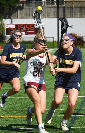 BRYAN EATON/Staff photo. Newburyport's Maggie Pons passes as Andover's #21, left, and #18 put the pressure on.