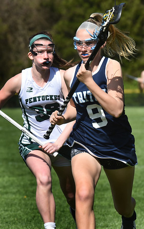BRYAN EATON/Staff photo. Pentucket's Brooke Yemma follows behind Volpore.