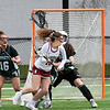 BRYAN EATON/Staff photo. Margaret Cote tries to score against Manchester-Essex.