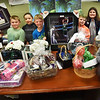 BRYAN EATON/Staff photo. Several members of the Lower Merrimack Valley Boys and Girls Club in Salisbury show off some of the many items for their upcoming auction. Clockwise, from left, Max Fitzwater, 9, Parker Jolivet, 10, London Cole, 10, Cooper Keenan, 9, Brandon Arcidiacono, 10,   Ginny Bishop, 9, Natelia Ortez, 8, and Chloe Borrelli, 7.