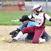 JIM VAIKNORAS/Staff photo Triton's Emily Karvielis collides with Newburyport's Mikayla Vincent as Vincent steals second at Triton Wednesday.