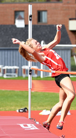 JIM VAIKNORAS/Staff photo Amesbury's Brook Taylor finishes second in the high jump at the Pentucket, Amesbury, Newburyport meet at Fuller Field Wednesday.