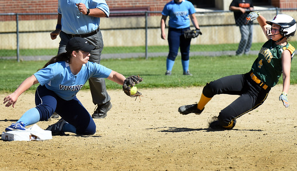 BRYAN EATON/Staff photo. Triton second baseman #21 has the ball in hand to force out North Reading's Abigail Paine.