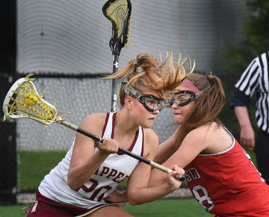 BRYAN EATON/Staff Photo. Newburyport's Maggie Pons battles with a Masco player.
