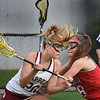 BRYAN EATON/Staff Photo. Newburyport's Maggie Pons battles with a Masco player.