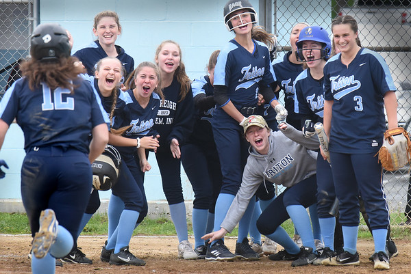 BRYAN EATON/Staff Photo. Triton softball players cheer teammate Emily Karvielis coming in for a two-run homer against North Reading.