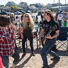 JIM VAIKNORAS/Staff photo The guitar player for Vinyl Legion Band dances with the crowd at  Plum Fest Saturday at Plum Island Center. The band was one of almost 100 to entertain thousands of music lovers throughout the day.