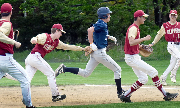 BRYAN EATON/Staff Photo. The Newburyport infield scrambles to nab a Lynnfield player stuck between second and first base with second baseman Tyler Koglin making the tag.