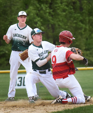 BRYAN EATON/Staff Photo. Pentucket's Guy Flaherty gets out a Masconomet player out at second as Trevor Blanchard looks on.
