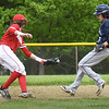 BRYAN EATON/Staff Photo. Amesbury shortstop has the ball, but Essex-Tech's # 5 gets a safe steal to second.