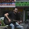 JIM VAIKNORAS/Staff photo  Tag Baker of Salisbury plays guitar at Salisbury Beach Center on a warm Memorial Day weekend.