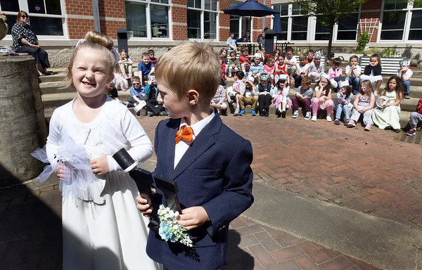 """BRYAN EATON/Staff Photo. Avery Couture, playing the letter Q, pauses before saying """"I Do"""" to be forever together with the letter U, played by Thomas """"TJ' O'Keefe in a """"marriage"""" of the two letters. Aimee Farrell's kindergarten class, and others, continue to learn about spelling and the English lanquage and staged the wedding to bring home the point that Q and U always go together in words."""