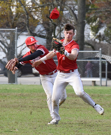 BRYAN EATON/Staff photo. Amesbury's Tucker Molin, left, and Logan Burrill collide to catch a popup with the ball ending up in Burrill's mit.