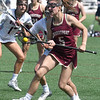 JIM VAIKNORAS/Staff photo Newburyport's Melania Lucci makes a move against Sudbury during the Harlem Lacrosse Tournament in Boston Saturday.