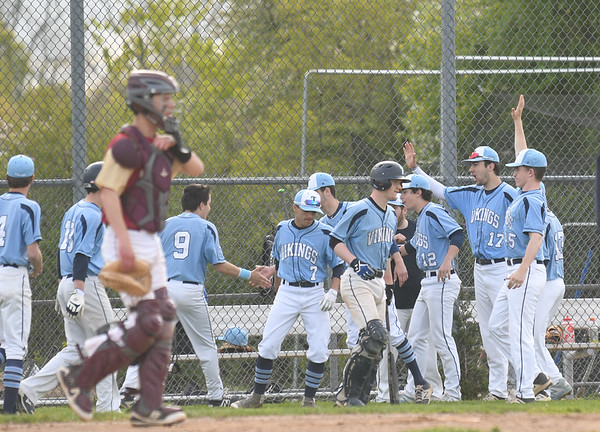 JIM VAIKNORAS/Staff photo Triton celebrate an early inning run against Newburyport at Triton Thursday.