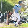 JIM VAIKNORAS/Staff photo Newburyport catcher Nicholas White field a bunt layed down Triton's Andrew Maiuri at Triton Thursday.
