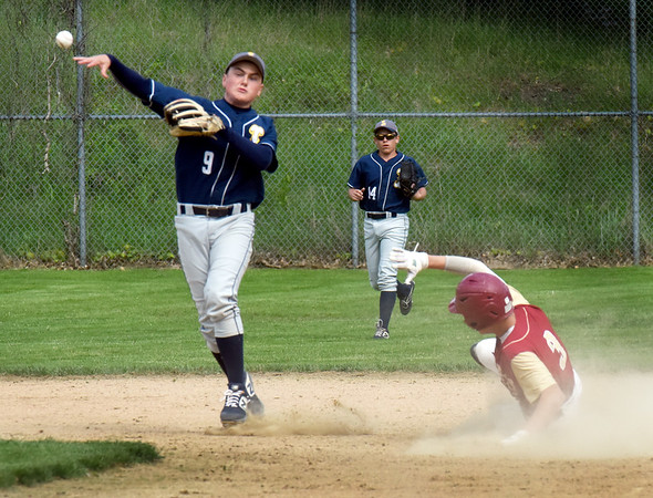 BRYAN EATON/Staff Photo. Newburyport's Ryan Archie comes up short at second base.