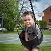 BRYAN EATON/Staff Photo. Luke Beal, 2, is all smiles as his mother, Melissa, pushes him on a swing on Monday afternoon. The two, from Amesbury, were at Cashman Park in Newburypor with eyes on the sky as dark clouds approached.