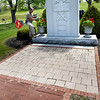 BRYAN EATON/Staff Photo. Retired Amesbury firefighter Ozzie Morrill maintains the Firemen's Memorial on Route 110 in Amesbury. Bricks have been sold in memory of former firefighters, and now bricks away from the monument can be bought by other members of the community.