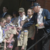 JIM VAIKNORAS/Staff photo troop 219 members Eloise Langlais, 11, Maddie Sarno,11, Violet Burns, 11, Katie Conway, 12, and Erin Casio, 11, get some help from Verterans Agent Keven Hunt as they lead the Pledge of Allegiance  at the Memorial Day Service at Newburyport City Hall Monday morning.
