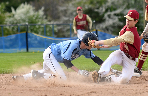 JIM VAIKNORAS/Staff photo Triton's Cael Kohan is tagged out at second by Newburyport's Tyler Koglin at Triton Thursday.