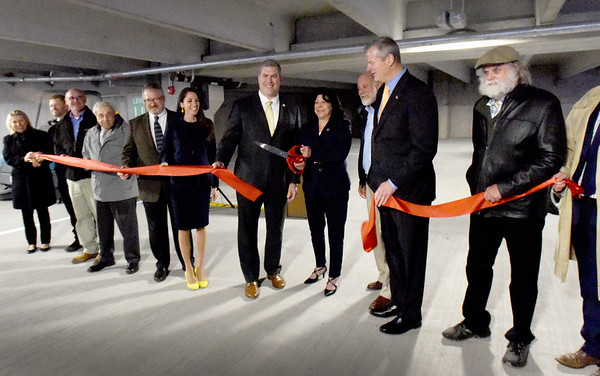 BRYAN EATON/Staff Photo. Flanked by state and city officials, Newburyport Mayor Donna Holaday cut the ribbon to open the city's new parking garage which could open as soon as Friday.