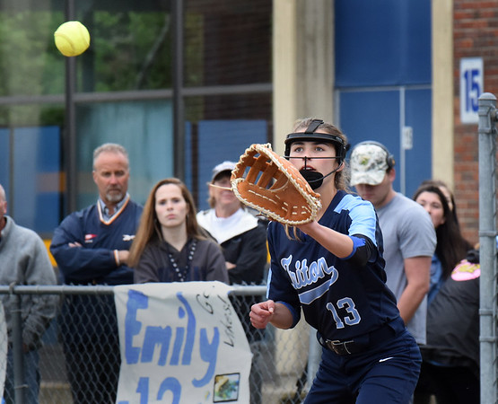 BRYAN EATON/Staff Photo. Triton first baseman Mia Berardino makes the catch forcing out North Reading player #25.