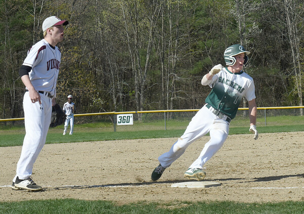 BRYAN EATON/Staff Photo. Pentucket's Gus Flaherty makes third on an error at home plate.