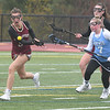 JIM VAIKNORAS/Staff photo Newburyport's Melaina Lucci is guarded by  Triton's #7 at Triton Friday.