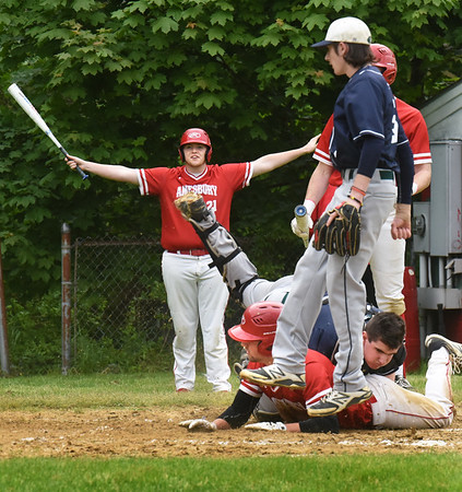 BRYAN EATON/Staff Photo. Amesbury's Derek Beaupre signals Tucker Molin as safe at home and he is correct.
