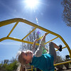 BRYAN EATON/Staff Photo. The reclusive sun returned on Monday to the delight of youngsters who can return to outdoor recess like Lilly Blake, 7, on the monkey bars at the Cashman School in Amesbury. The weather is unsettled until the weekend arrives with some sun and rain in the forecast.